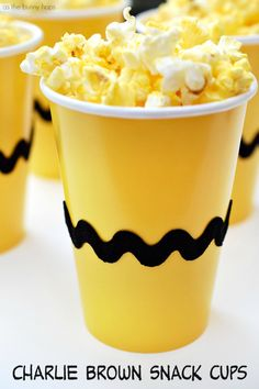 Get ready for a The Peanuts Movie family movie night with these easy to make Charlie Brown Snack Cups. Perfect for popcorn, snacks...or...you can drink from them!