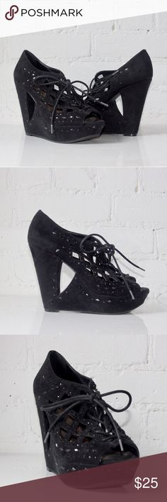 Platform Wedges with Studs Black platform wedges with studs. Intricate design on top and sides. Lace up style on front. Gently used condition. Fit true to size. Heel height = 5in. Please ask any questions before purchasing. Open to offers! Gianni Bini Shoes