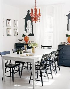 black chairs white table--not this dining light though