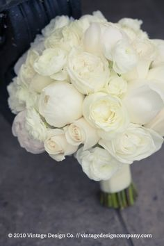 A very soft and creamy delicate bouquet of garden roses, peonies and ranunculus.