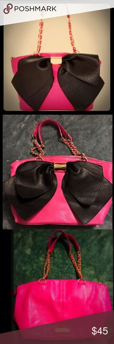 Betsy Johnson Big Bow Purse It's in really GOOD condition no scratches or wear in the leather... am missing the keychain it comes with and i of the ropes in the chain needs to be sewed , repaired , or superglued. Besides that , it's in excellent conditions !! Betsey Johnson Bags