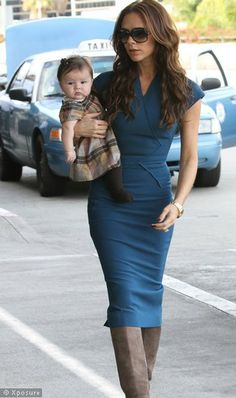 If only we could all carry a baby this way with these kind of boots and that kind of body!