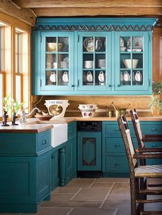 turquoise-painted cabinets, A deep red Mexican saltillo tile floor and rough-cut ceiling beams (known as vigas), Butcher-block countertops, wood paneling, Rustic Kitchen, New Kitchen, Country Kitchen, Kitchen Ideas, Glass Kitchen, Western Kitchen, Vintage Kitchen, Knotty Pine Kitchen, Teal Kitchen Decor