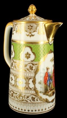 Antique Rare Richard Klemm Dresden Rococo HP Chocolate Pot. Circa 1891 to early 1900s. Heavy golden scroll work and ornate designs cover the entire body and focus on a central cartouche that contains a hand painted scene of an 19th century courting couple.