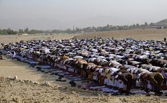 Afghans offer Eid al-Adha prayers in Jalalabad east of Kabul, Afghanistan, which is marking the holiday under a wave of violence.