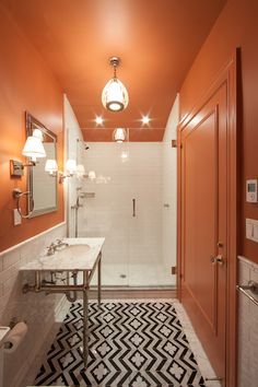 Orange & Black Bathroom. Ceiling and walls painted same color for seamless look & big impact. The Renovated Home