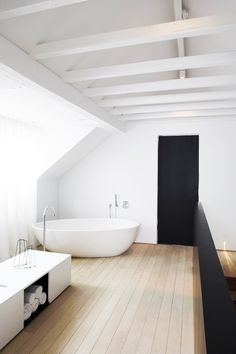 Like the floor, white beams and that there is a strength of colour in there (although wouldn't want use black ourselves)