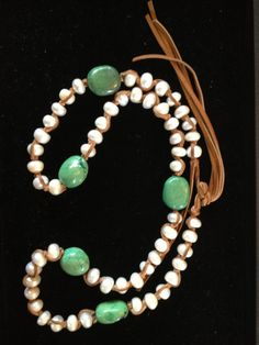 This great lariat styled necklace wraps twice around your neck or it can be worn long too.  This necklace is hand knotted with extra large freshwater pearls combined with beautiful green turquoise and saddle brown lambskin leather knots to bring nature's great gifts to your arsenal of baubles.