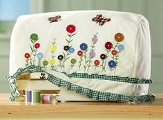Flower Buttons Design Sewing Machine Storage Cover from Collections Etc. Sewing Hacks, Sewing Tutorials, Sewing Crafts, Sewing Projects, Sewing Room Decor, Sewing Rooms, Pfaff, Appliance Covers, Collections Etc