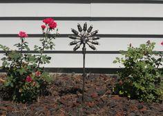 Spark Plug Flower Stake Metal Sculpture Yard Art Garden Art Found Objects FOREVER FLOWER. $54.75, via Etsy.