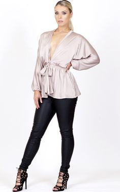 Keep your heads high and your necklines low, ladies. This blouse comes in champagne and navy. It features a plunging neckline, long full sleeves and a tie in waist. This can be a day to night outfit. Dress it up or down as both look unreal!