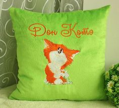Green pillow with romantic Cat embroidery design
