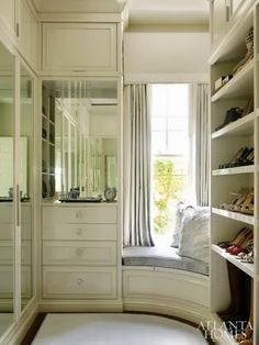 I love the curved seating. The corners in a closet can be such wasted space. This would be the perfect solution. His and her seats for.putting on your shoes.