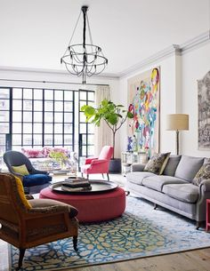 How plants can work in any interior style: A colourful Manhattan apartment gets some extra green from a tall Fiddle Leaf Fig with bare stem.
