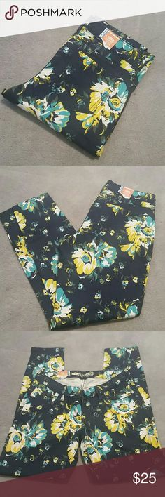"NWT Old Navy Rockstar Floral Jeans sz 10 Awesome bold floral print! Navy jeans with turquoise, yellow, white and olive floral pattern. Brand new, with tags,  never worn, from a smoke and pet free home...pattern no longer available!  91% cotton /6% polyester / 3% spandex  Approx Measurements :  Waist 15"" flat, unstretched  Rise 8"" Inseam 28.75"" Old Navy Jeans Skinny"