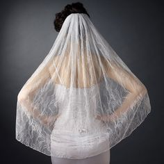 Single Layer Fingertip Length Embroidered Lace Veil in Ivory http://www.allysonjames.net/item_859/Mantilla-Cathedral-Length-Lace-Edge-Veil-108--Top-Edge-PencilSerged.htm