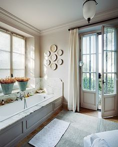 So classic.  And so inviting.  Say 'yes' to French doors in the bathroom!
