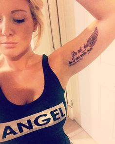 """Do not fear, for I am with you Isaiah 41:10"" bicep tattoo with angel wing"
