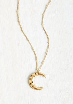 Subtle sparkle? Check. Celestial charm? Absolutely. Favorite-accessory potential? You bet! With a dotted chain supporting its moon-shaped pendant touched with blush rhinestones, this gold necklace checks off all the boxes of your specific style criteria!