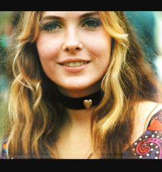 At a 1967 love-in in Los Angeles  Hippie Girl with Orange by Henry Diltz