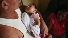A disease linked to the Zika virus in Latin America poses a global public health emergency requiring a united response, says the World Health Organization.  Three-month-old Alice Vitoria Gomes Bezerra, who has microcephaly, held by her father Joao Batista Bezerra in Recife, Brazil. 27 Jan 2016