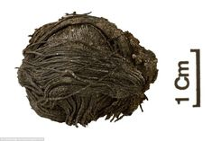 Two perfectly preserved pieces of 3,000-year-old thread - one in a ball and another wrappe...