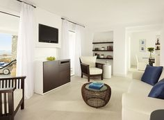 One of the living rooms of one of the Mykonos Grand 5 Star Luxury Resort & Hotel suites. Mykonos Luxury Hotels, Myconos, Luxury Accommodation, Hotel Suites, Luxury Holidays, Grand Hotel, Resort Spa, Hotels And Resorts, Interior