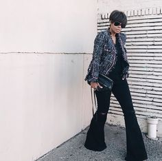 black and white tweed jacket + black shirt + black purse + black bel flare jeans