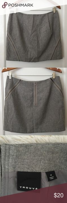 """TrouvéGray Mini Skirt with Zipper Detail *Size: MEDIUM *Shell: 53% wool, 29% polyester, 14% viscose, 4% other fibers. Lining: 100% polyester  Approx. Measurements:   Waist: 31"""" Length: 15.25"""" Hips: 40"""" Tags: trouve skirt miniskirt gray size medium Trouve Skirts Mini"""