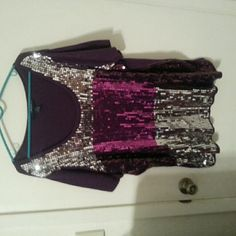 Gorgeous purple sequin top This top is quality made and has no sequins missing. Only been worn a few times and will add flash to any outfit! Tops Blouses