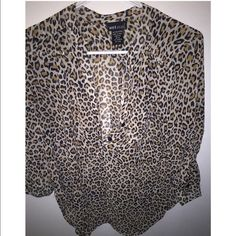 Wet Seal cheetah print top Size medium. Never worn Wet Seal Tops Blouses