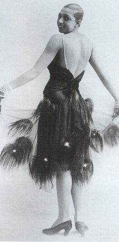 Josephine Baker w/ a peacock feather skirt overlay (LOW-backed, diamante straps and fitted bodice); probably early 20s (Deco holdover elements), and a line up the back of her stockings