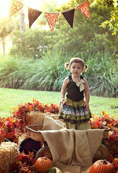 harvest set up - old wagon, burlap, hay bales and orange flowers