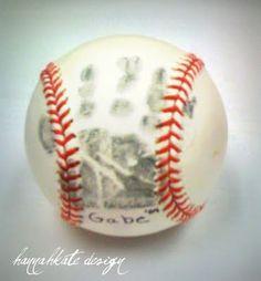 Newborn's hand print on baseball. YES.