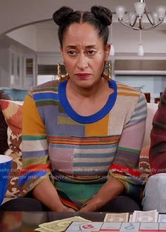 Rainbow's multi-colored sweater with split sleeves on Black-ish.  Outfit Details: https://wornontv.net/81974/ #Blackish