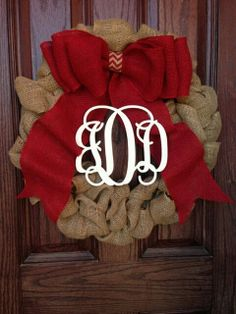 Burlap Christmas wreath with red bow and monogram on Etsy, $75.00