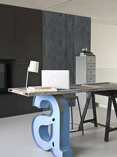 A steel sawhorse and two salvaged finds—an old door and a giant metal letter—combine forces to create a one-of-a-kind desk. This workspace is from Midbec Wallpapers, found on Frenchy Fancy.