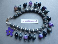 nickibear jewellery (rtm) signature style gemstone charm bracelet, with Coloured Agates, Haematite and Blue Goldstone beads, from Etsy.