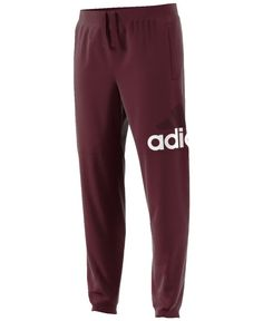 Sports-inspired and perfect for relaxing, these adidas pants give you a sleek look plus comfort. | Cotton/recycled polyester | Machine washable | Imported | Tapered fit | ClimaLite® wicking technology