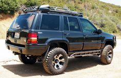 """Rubicon Express RE8300 Extreme Duty Long Arm System 4.5""""  Kevin's Offroad Safari Roof Rack, with some customizing done.  WAAG brush guard, with custom reinforced mounts."""