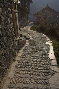 One of the narrow streets of Xijiang, Xijiang, China Would love a pattern like this on a walkway Places Around The World, Around The Worlds, Beautiful World, Beautiful Places, Garden Paths, Stairways, Beijing, Places To See, Garden Design