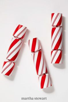 Christmas crackers -- prettily wrapped cylinders that hold tiny gifts and emit a loud pop when pulled apart -- date back to mid‐19th‐century Great Britain. Place a pile in a bowl by your front door, and send guests home with a jolly fun party favor. #christmas #holidayideas #christmasideas #wintertodo #marthastewart