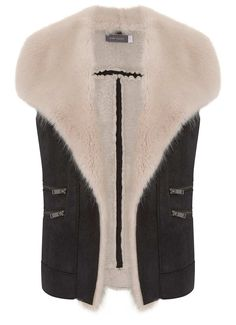 Inspired by aviator styling, add a touch of luxury in this black suedette gilet with a cream faux fur trim and zip detailing. Model is 5'10in and wears a UK size 10.The length from side neck point to hem measures 60cm/23.5in.