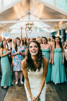 Bouquet toss to wedding guests and teal bridesmaids at Twigs Tempietto    Venue, Flowers, and Catering at Twigs in Greenville, SC