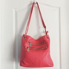 "Hot Pink Cross Body Bag Hot pink Cross body Bag  ·         Faux leather ·         Silver hardware ·         Zip closure ·         Adjustable shoulder strap ·         2 zipper pockets on front ·         Interior zipper pocket ·         Measures 13.5""x2.5""x12"" ·         Strap 25"" Bags Crossbody Bags"
