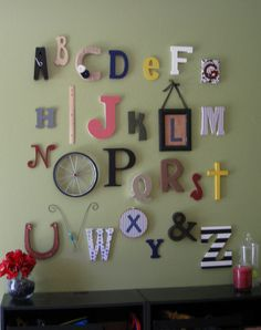 alphabet wall love the clothespin for a ruler for i and wheel for o the cross for t and bw striped z