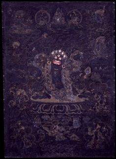 "Drogdze Wangmo, Mistress of the Charnal Ground, is an example of a wrathful female protector deity associated with specific ""revealed"" treasure (terma) teachings of the Nyingma tradition of Tibetan Buddhism. In a horrific form, and often surrounded by terrifying retinue figures who are denizens of the cemeteries and charnal grounds, she holds in her right hand a heart freshly acquired from an enemy and in her left hand a mirror to reflect the karmic deeds of those she is protecting against."