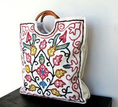 Adorable tote. This reminds me of the vintage embroidered pillows my grandmother had on her couches:)