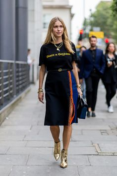 At London Fashion Week, stylist Pernille Teisbaek teamed a relaxed black slogan tee with a Gucci belt and colour-block skirt complete with two-tone, loop-detail slit. (How much do we love that zesty slash of orange?) And she gets a gold star for those Balenciaga boots!