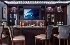 Interior : Classic Traditional Home Bar Style With Elegant Entertainment Area Wall Mounted TV Also Surfing On Blue Ocean Wooden Material Str. Decor, Home, Stripe Accent Chair, Sweet Home, Contemporary House, Traditional House, Bars For Home, Interior Design, Home Bar Designs
